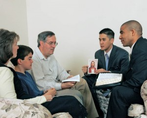 A family gathered together to listen to the missionaries.
