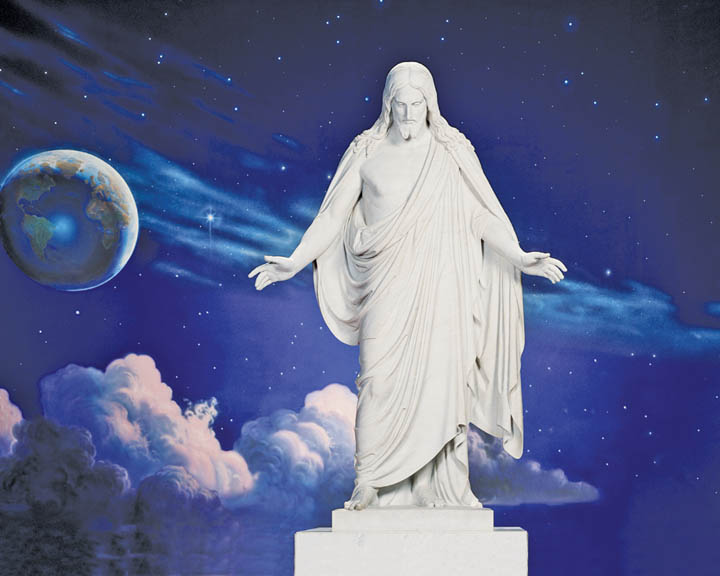 A photo of the Christus Statue in front of a mural of the universe.