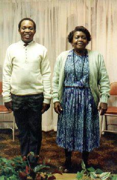 A photo of the author, Keith, and his mother standing side by side in their home.