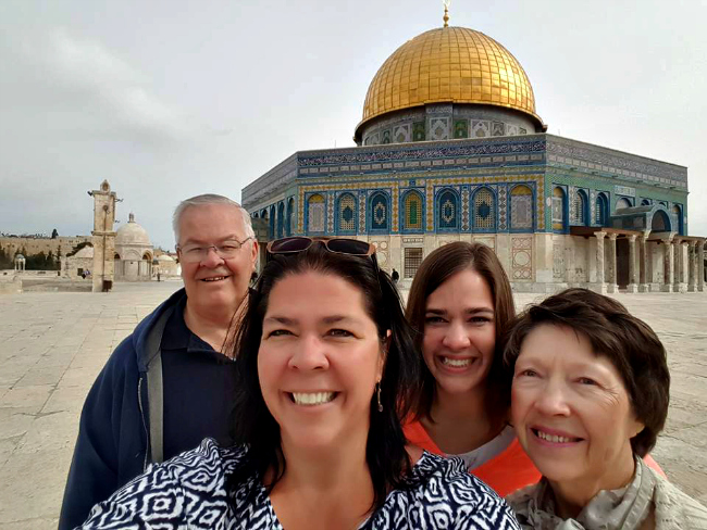 Darrell, Destinee, and Darla Bushman and Delisa Hargrove smile in front of the Dome of the Rock